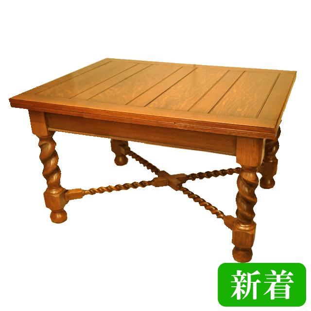 オーク材で作られたツイストレッグの伸長式可能なアンティークドローリーフテーブル